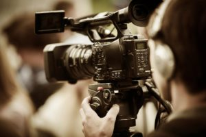 Graphic of HD Video professional working the camera